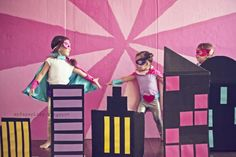 Girly Superhero Party: DIY painted backdrop made from a fridge cardboard box (often free from Lowe's/Home Depot!)