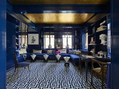 Kelly Behun design.   Blue laquered walls, bold blue and white rug from Stark, blue banquet sectional, gold ceiling and Morphosis tables.