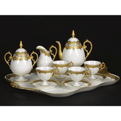 A PORCELAIN GILT PART COFFEE SERVICE, LATE 19TH CENTURY comprising: a two-handled oblong tray, 59.2 cm. wide; a coffee pot and cover; a sugar pot and cover; a cream jug; four cups and six saucers