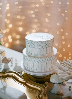 white and blue-stitched cake // photo by Anna Page Photography // http://ruffledblog.com/english-inspired-milwaukee-wedding