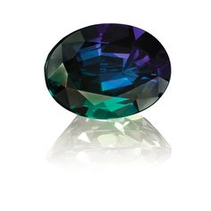 Alexandrite, even a Gemini's birthstone is a dichotomy. Is it purple or green? Both!