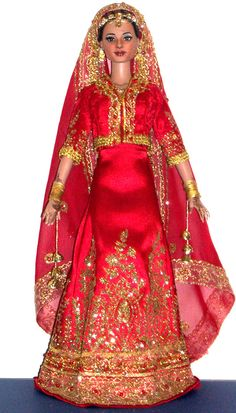 https://flic.kr/p/iM1QRV | Indian Bride Commission | This 16 inch doll was a commission of a potrait doll as a wedding gift. it is a detailed replica of the bride and her ensemble for her wedding, down to her jewelry and outfit and shoes. Another great collaboration with Dal on the outfit!