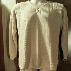 Lovely 20W silk blend sweater, 3/4 sleeves Versatile cable knit oatmeal colored sweater with pearlized buttons and side slits. Perfect for spring. Silk blend gives a great drape and weight. Gently worn, very light pilling as shown in pics. Good used condition. Yarnworks Sweaters
