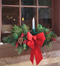 Christmas decorating just got easier and more elegant with our artificial window swag with candle. An update on a classic plow and hearth favorite, Plow & Hearth new design adds faux red berries, pine Christmas Window Boxes, Christmas Window Decorations, Christmas Swags, Christmas Arrangements, Christmas Centerpieces, Rustic Christmas, Christmas Lights, Diy Christmas, Primitive Christmas