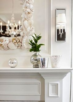 Crisp white. Lovely shelled mirror. Mirrored sconces.