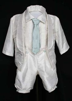 Jack Outfit             $500                            Such a little man outfit! Silk dupioni from head to toe. A pleated silk shirt with fabric buttons; baby blue full length tie; knickers with pleats and blue buttons; and a suit jacket to top it all off. Completely adorable.                  Sizes 3m-18m