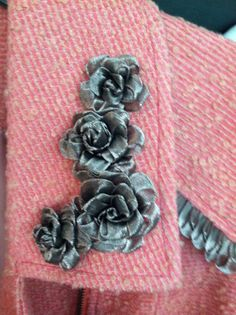 Roses from Sweet Briar class on a coat