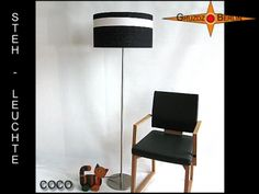 Stehleuchte COCO h 155 cm Stehlampe Schwarz Weiss.  Eine Klassiker-Stehlampe aus schwarzem Leinen mit aufgesetztem Batyline-Gitternetzgewebe. Ein echter Hingucker durch elegante Verspieltheit und schöne Details.