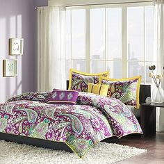 Liven up your bedroom with the bright and bold Melissa Reversible Comforter Set. Decked out in a large purple and white paisley print with bright yellow accents, the beautiful bedding is an eye-catching touch to any room's décor.