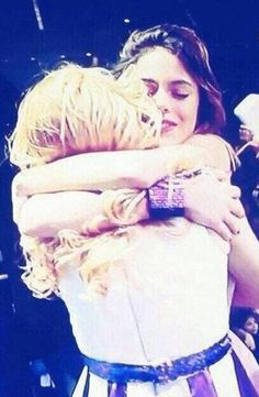 Tini and Mechi hug