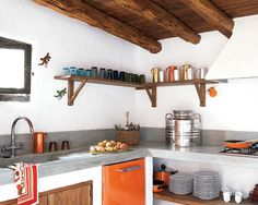 """""""The stained concrete, exposed beams, stripped wood, boulders and whitewashed walls and the use of natural material all enhance the feeling of freshness and respond to the intention of the owners to maintain the spirit of the rural architecture of the island [Formentera, Spain]."""""""