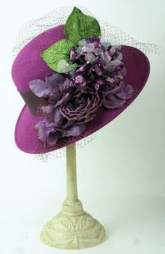 Louise Green Purple Haze Hat      Fabulous. From the legendary designer, violets and sterling roses converse upon a plush, velour finished fur felt wide brim.Arrives in a keepsake hatbox. USA.