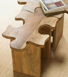 Jigsaw puzzle stools. You can put them together to make a coffee table or use them apart as ottomans or stools.
