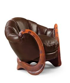 World's Most Expensive Chair: The Dragons Chair was made by Eileen Gray sold for $  28.3 million, shattering the auction record for a 20th century decorative artwork. We create a good and authentic replica of the chair and price starts from $58,750 for more details send us email.