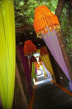 Drapes and floral lanterns at walkways.
