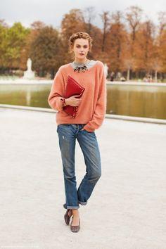 preppy chic: braided hair, peach pullover, boyfriend jeans