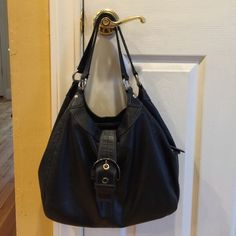 Coach black bag Coach black bag very gently used. 14in across and 10 inches in height. Shoulder strap is 8 inches. Has 3 sections, space for cell phone, middle section has zipper and outer sections have magnets Coach Bags Shoulder Bags