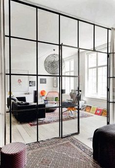 Eclectic Trends | Its Trending: metal black framed room dividers...or thin mirrors on a wall to creat the illusion of more space.