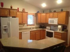 Maple Cabinets And White Quartz Countertops With Appliances Similar Kitchen Layout