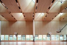The multi-functional sports hall is timber-frame constructed with straw insulation and forms a neighborhood hub in the heart of Bon Lait, an urban developmen...
