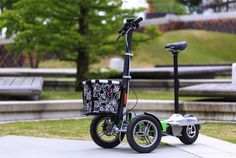 The Scuddy electric folding scooter stands up, sits down and trolleys