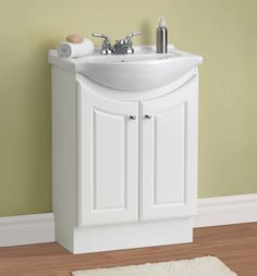 Transform your small bathroom space into a breathtaking place with this 24'' Eurostone Collection Vanity Ensemble. This space-saving design features a two-door vanity base, a White Porcelain Vanity Top with integrated bowl and beautiful chrome hardware. Coated in a wonderful Matte White Finish, this vanity set adds soothing simplicity to even the smallest space.