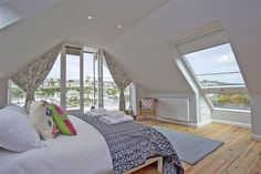 Positioned in a prime waterside location, Point Cottage, a fabulous, extensively refurbished, detached cottage boasts stunning estuary views whilst being in the heart of Noss Mayo. Attic Master Bedroom, Attic Bedroom Designs, Bedroom Balcony, Bedroom Loft, Bedroom Decor, White Bedroom, Bedroom Furniture, Loft Conversion Balcony, Loft Conversion Bedroom
