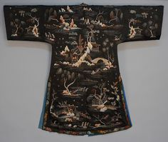 Chinese embroidered silk robe, mid 20th c.Black decorated with landscape having bridges, fisherman and figures in houses, with banded collar and side slits, small satin frogs (one missing), blue silk lining, back view