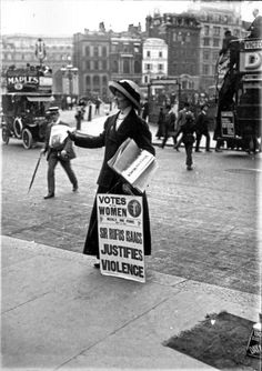 A Suffragette Handing Out Newspapers
