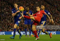 Philippe Coutinho of Liverpool holds off Danny Simpson of Leicester City during the Barclays Premier League match between Liverpool and Leicester City at Anfield on December 2015 in Liverpool,. Barclay Premier League, Liverpool Fc, Liverpool England, Premier League Matches, Leicester, Manchester City, Hold On, Basketball Court, Philippe Coutinho