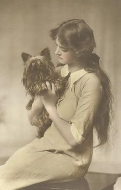 Edwardian young woman with her dog. Looks like Gladys Cooper