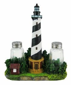BEACON SEASONS Lighthouse Salt & Pepper Shaker Set by Things2Die4. $13.50. This cool lighthouse salt and pepper shaker set looks great in kitchens or on dining tables. Made of cold cast resin, the glass shakers fit perfectly into the bushes on the left and right side of the lighthouse. It measures 8 inches tall, 7 inches wide and 3 1/4 inches deep, and the shakers are 3 1/8 inches tall. It makes a great gift for any lighthouse lover.