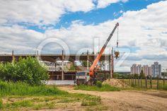 Qdiz Stock Photos | Building under construction,  #architecture #beam #build #building #construct #construction #crane #development #engineering #equipment #exterior #grass #ground #industrial #industry #sand #site #sky #truck #under #work #workplace