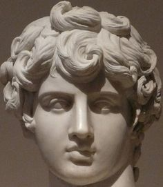 """A close-up of """"The Young Antinous"""", Roman bust (2nd century CE) on display at Museo Nazionale Romano, Rome. Antinous was a extraordinary handsome boy. Emperor Hadrian met him in Bythinia and fell in love, taking him to Rome. The emperor wept for Antinous publicly when, in 130 CE. the young man mysteriously drowned in the Nile"""
