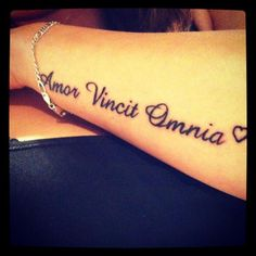 Amor Vincit Omnia. Have this on the back of my neck! Steven has it on his leg <3