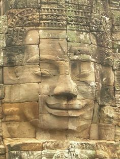 One of the many faces at Angkor Wat. The Definitive Guide to Moving to Southeast Asia: Cambodia. #Cambodia #expat http://www.wanderingeducators.com/southeast-asia/cambodia/definitive-guide-moving-southeast-asia-cambodia.html