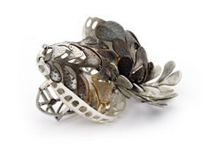 Anna Vlahos. Brooch: Horde, 2013. Sterling Silver, 24ct gold, sapphire, citrine. 6 x 4 x 2.5 cm.