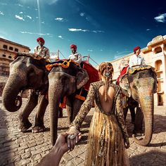 The famous Russian photographer who was following his girlfriend around the world has gone to India and taken #followmeto to the next level. This time Osmann's now fiancée Natalia Zakharova is dressed in stunning Indianized costumes and posed in front of historic locations in Delhi, Udaipur, Varanasi, Jaipur, and more.