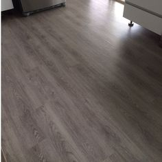 The Grey Gum from our Illusions loose lay range Looks very smart and modern in any setting. Available at #evolvedluxuryfloors  This one is installed through the kitchen area looks perfect.  Vinyl flooring that looks like wood ideal for any residential or commercial application. #illusions #looselay #vinylflooring #goldcoast