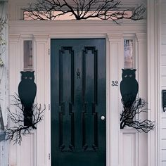 A pair of wide-eyed owls guard the front door.