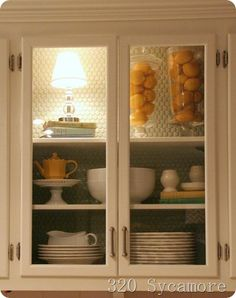 glass doors for the kitchen cabinet   love the light in the cupboard