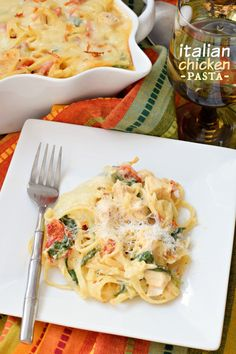 Creamy pasta filled with chicken, sun dried tomatoes and spinach! Bake in a casserole topped with lots of cheese, YUM!