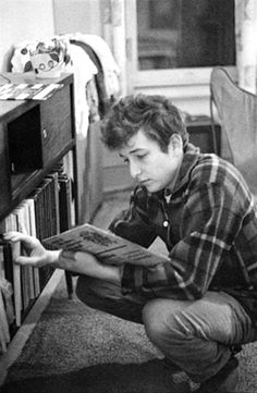 Baby Bob Dylan, 1962, digging the record collection of photographer Joe Alper at his home in Schenectady, NY