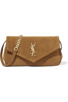 Tan suede (Calf) Snap-fastening front flap Designer color: Light Ochre Comes with dust bag Weighs approximately 1.3lbs/ 0.6kg Made in Italy