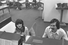 Telephone operators in the 70s (with perspex dividers)