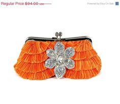 Tangerine Destination Wedding Clutch Crystal Orchid Brooch. $84.60, via Etsy.