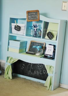 What a cute idea to repurpose and old shelf or hutch to make a little center for the kids.  Love her ideas!