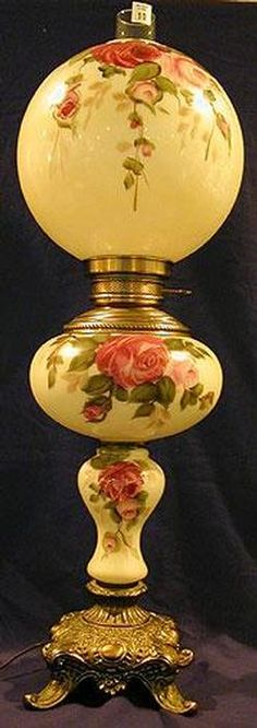 lighting, , An unattributed triple globe Gone With The Wind lamp with font and shade floral paint decorated and on footed base.
