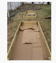 Lay down a thick layer of CARDBOARD (or few layers of newspaper) in your raised garden beds to kill the grass. (mow first) It is perfectly safe to use and will fully decompose, but not before killing any grass below it. They'll also provide compost and food for worms.