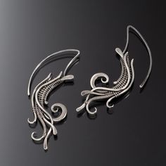 A fun tribal inspired earrings made from fine silver wire that has been hand sculpted, hammered, filed and woven together into a delightful design.